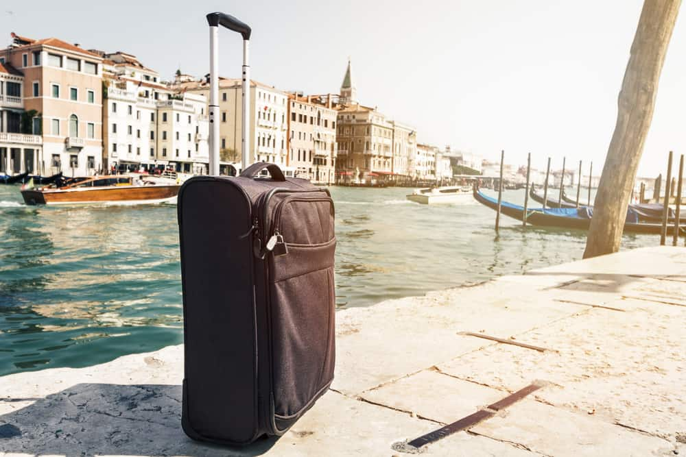 suitcase-next-to-canal-in-Venice-Italy